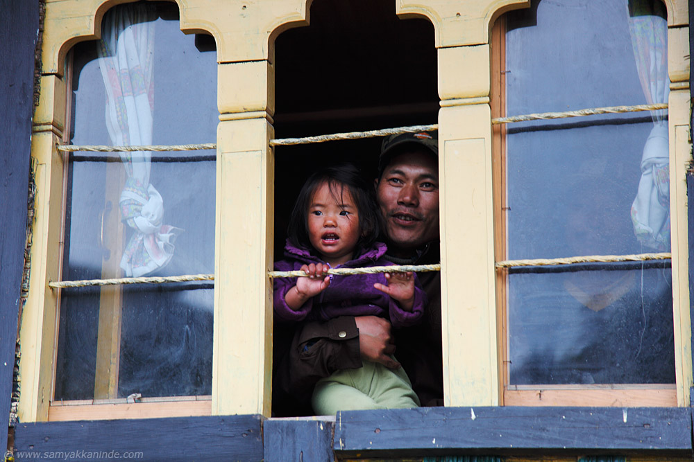 father and his daughter at pele la, bhutan.