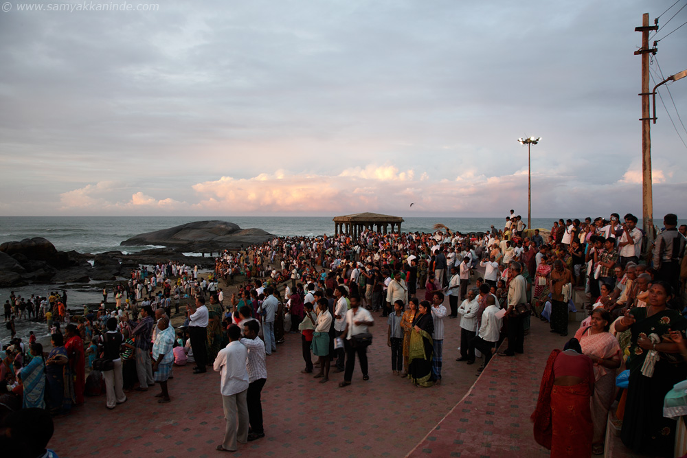 The crowd gathered at the beach to watch the sunrise.